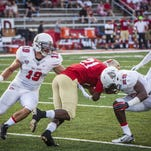 Ball State's Ben Ingle and Corey Hall stop a play by VMI during their game at Scheumann Stadium earlier this season.