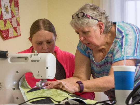 Tish Wright, right, works with Lauren Back, left,  during an instructional class at the Cotton Candy Quilt Shoppe.