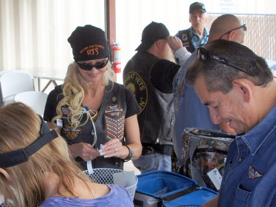 From left, Delia Milo, Natasha Jasso and Frank Milo buy door prize tickets during registration for the third annual Forgotten Veterans Memorial Bike Run on Saturday at the American Legion Bataan Post 4.