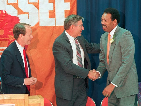 Wade Houston, right, is welcomed as the new University