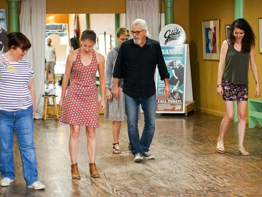 Harold Bernard, center, teaches a waltz and two-step to French journalists touring Lafayette.