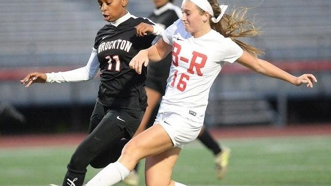 Bridgewater-Raynham girls soccer player Cassie Tofteroo, right, battles a Brockton defender for the ball during a 2019 game at Bridgewater-Raynham Regional High School.