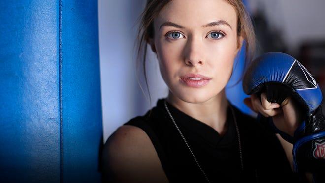 A study in contrasts: Elizabeth van der Horst is a model, reiki healer and mixed martial arts fighter.