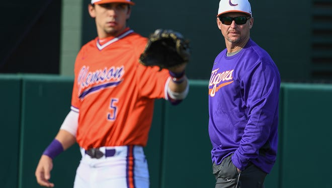 Coach Monte Lee, shown in a file photo watching players warm up, and the Tigers play Furman at Fluor Field Tuesday night.