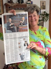 Jane Goldsworthy holds up a copy of the Des Moines Register with David Letterman's photo.
