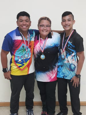 Youth bowlers, from left, runner up Darien Borja, champion Eya Salandanan and third place Frank Manbiusan Jr.