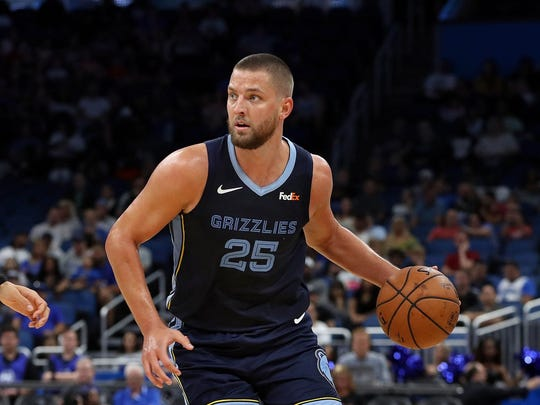 Oct 10, 2018; Orlando, FL, USA;Memphis Grizzlies forward Chandler Parsons (25) drives to the basket as Orlando Magic forward Aaron Gordon (00) defends during the second quarter at Amway Center. Mandatory Credit: Kim Klement-USA TODAY Sports