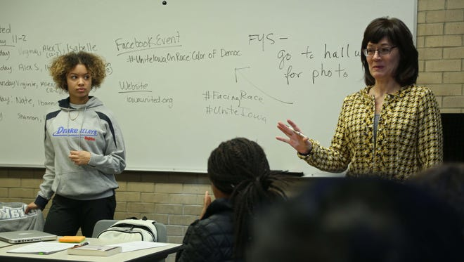 Drake professor Carol Spaulding-Kruse and Drake student Virginia Hill speak during Spaulding-Kruse's class on Feb. 18, 2016. The students in the class helped produce a Unite Iowa series on race.
