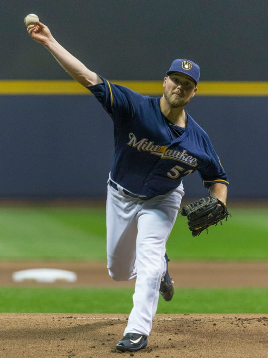 Milwaukee Brewers' Jimmy Nelson pitches to a San Fransisco Giants batter during the first inning of a baseball game Tuesday, April 5, 2016, in Milwaukee. (AP Photo/Tom Lynn)