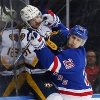 Rangers center J.T. Miller (10) and center Oscar Lindberg (24) scuffle with Predators defenseman Roman Josi during the third period at Madison Square Garden.