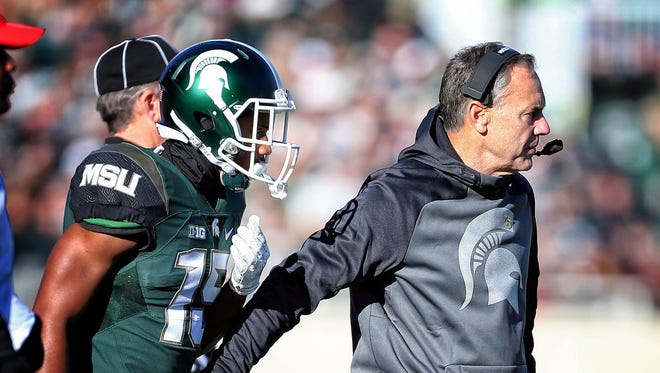 Michigan State Spartans head coach Mark Dantonio stands on the sidelines during the 1st quarter of a game against the Maryland Terrapins.