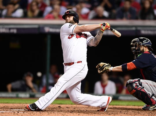 FILE - In this Oct. 6, 2016, file photo, Cleveland Indians' Mike Napoli bats against the Boston Red Sox during Game 1 of baseball's American League Division Series,in Cleveland. Napoli is getting another swing with the Indians. The free agent slugger has agreed to a minor league contract with the team, pending the completion of a physical. Napoli spent 2016 with the Indians and had a major role in getting the club to the World Series.(AP Photo/David Dermer, File)