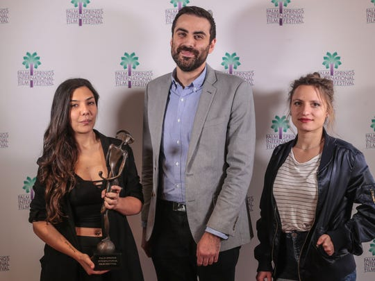 Palm Springs international Film Festival Artistic Director Michael Lerman with Laura Mora, the director of 'Killing Jesus' and Lea Mysius, director of 'Ava' pose for photos at a PSIFF event  on Saturday, January 13, 2018 in Palm Springs.