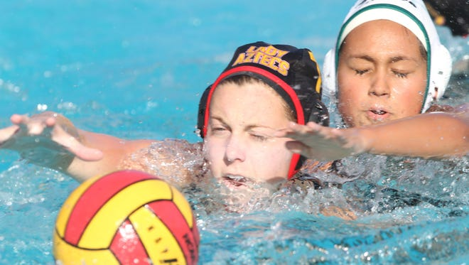 Palm Desert High School's Elise Stein, tries to recover a lose ball makes one of many saves during her game against Pacifica High School during their CIF game held at Indio High School.