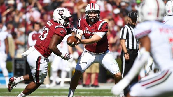 South Carolina quarterback Jake Bentley (4) hands the
