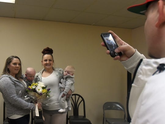 Adult Recovery Court graduates Annie McNamara and Amanda Jordan pose for a photo with their infant sons Joseph and Memphis. The two mothers completed the program while pregnant with and caring for their children, who motivated them throughout their recovery.