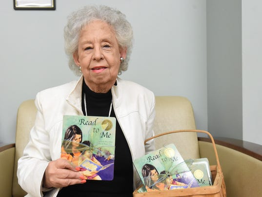 woman donates books
