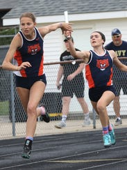 Galion's Jalyn Oswald hands the baton off to Kerrigan