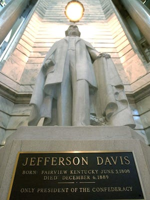 A statue of Confederate President Jefferson Davis stands in the Kentucky Capitol.