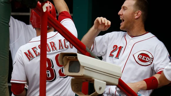 Reds third baseman Todd Frazier (21) celebrates with Devin Mesoraco after Mesoraco's two-run homer against Toronto on June 20.