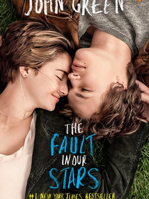 "The movie tie-in cover of  ""The Fault in Our Stars"" by John Green."