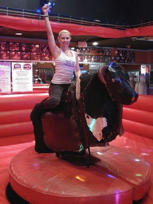 A challenger rides Buck Off, the state's only mechanical bull.