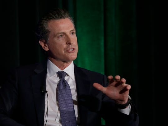 California gubernatorial candidate Lt. Gov. Gavin Newsom, a Democrat, discusses the state's housing problems at a conference on March 8, 2018, in Sacramento, California.