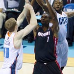 Miami Heat center Chris Bosh (1) attempts a shot against Charlotte's Cody Zeller during Game 4 of their NBA playoff series Monday. The game was still in progress at deadline. Go to citizen-times.com for a story.