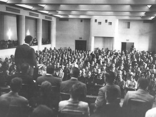1957 - Rev. Billy Graham addressing the crowd in the auditorium of Colgate Rochester Divinity School.