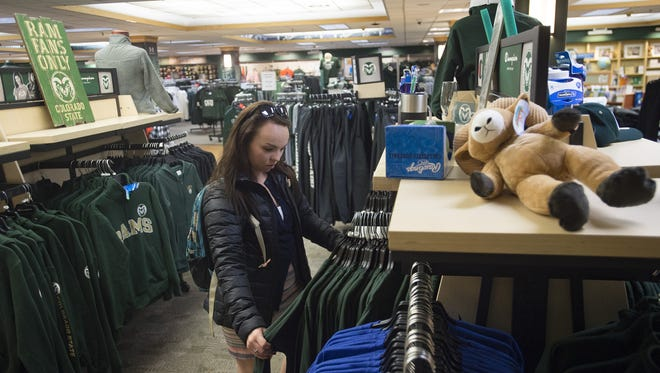 Syree Gunnels, a bio-medical science freshman, browses selections of apparel at the CSU Bookstore on Tuesday, November 28, 2017.