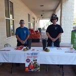 Firefighters Tony Nunez and Jonathan Little taking part in the Santa Rosa Professional Fire Fighters Association Local 4836's Fill the Boot campaign.