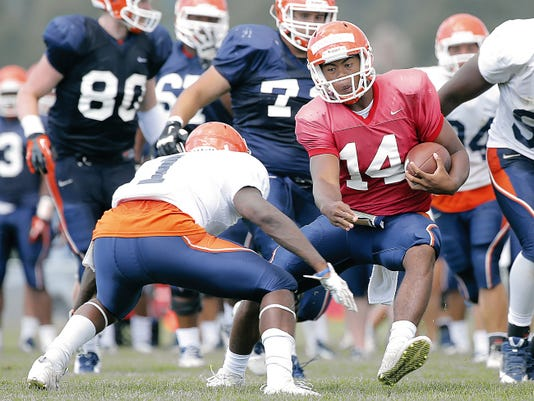 UTEP quarterback Kavika Johnson, a former Las Cruces Mayfield standout, picks up yardage this week at Camp Ruidoso. The offense has drawn coach Sean Kugler's praise.