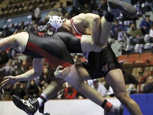 South Western's Seth Janney, right, takes down Reading's Matt Reinhart during the 220-pound championship match at the District 3 Class AAA tournament in February. Janney won the title and went on to finish as the runner-up in the state championships.