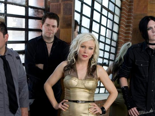 Terri Nunn (third from left) and Berlin.