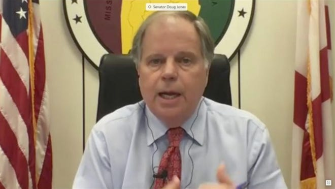"""Sen. Doug Jones, D-Ala., speaks remotely via teleconference during the May 12 Senate HELP Committee hearing on """"getting back to work and school."""""""