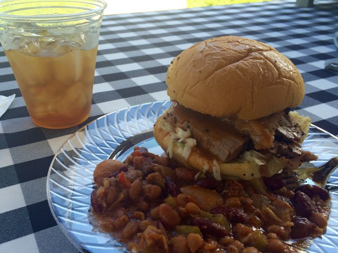 A brisket sandwich, Swamp Beans and sweet tea from