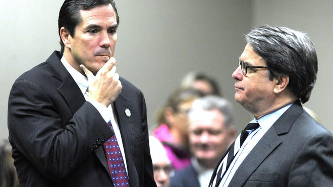 Michigan Health and Human Services Director Nick Lyon, left, talks with co-council Chip Chamberlain. The defense team's final preliminary exam witness testified Monday, May 21, 2018.