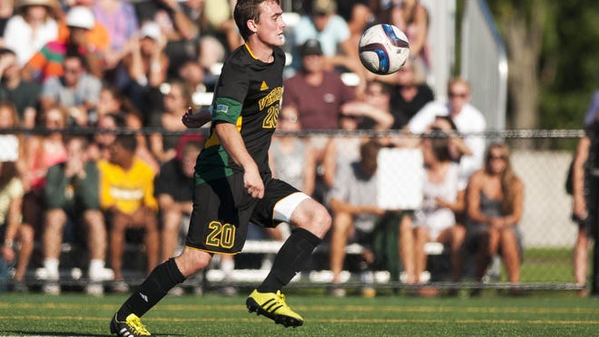 Vermont's Shane Haley (20) plays the ball during the men's soccer game between the UNC-Asheville Bulldogs and the Vermont Catamounts at Virtue Field on Sept. 11, in Burlington.