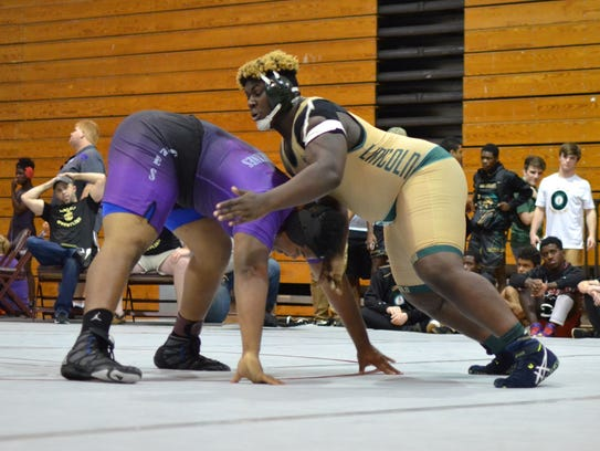 Lincoln heavyweight JT Rivers wrestles at the district
