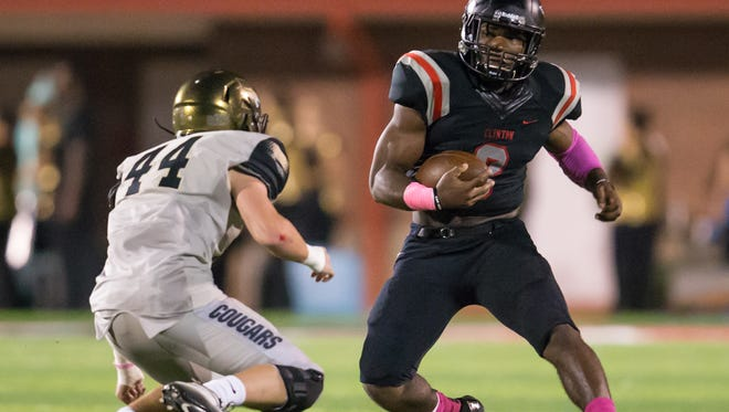 Clinton's Cam Akers looks to avoid Northwest Rankin's Harrison Tharpe (44) in the second quarter on Friday in a battle of top 10 teams.