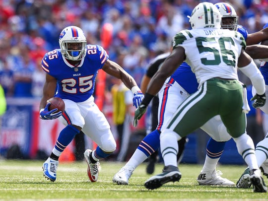 Sep 10, 2017; Orchard Park, NY, USA; Buffalo Bills running back LeSean McCoy (25) runs with the ball as New York Jets linebacker Demario Davis (56) defends during the first quarter at New Era Field. Mandatory Credit: Rich Barnes-USA TODAY Sports