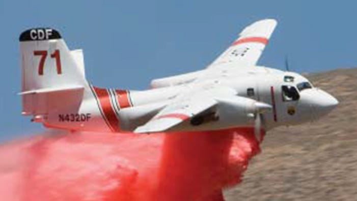 Photo shows a CAL FIRE S-2T air tanker dropping fire retardant on Sept. 23, 2007. This air tanker is similar to one that crashed near Yosemite National Park while battling a wildfire on Tuesday, Oct. 7, 2014. This photo was a handed out by Cal Fire to the media.