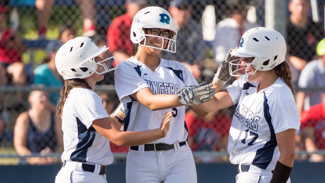Redwood's Prya Burns, left, Emily Ibarra and Sierra Moffett celebrate runs against Sanger in a Central Section Division II high school semifinal softball game on Wednesday, May 23, 2018.
