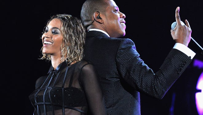 Beyonce (L) and Jay-Z perform onstage during the 56th GRAMMY Awards at Staples Center on January 26, 2014 in Los Angeles, California.