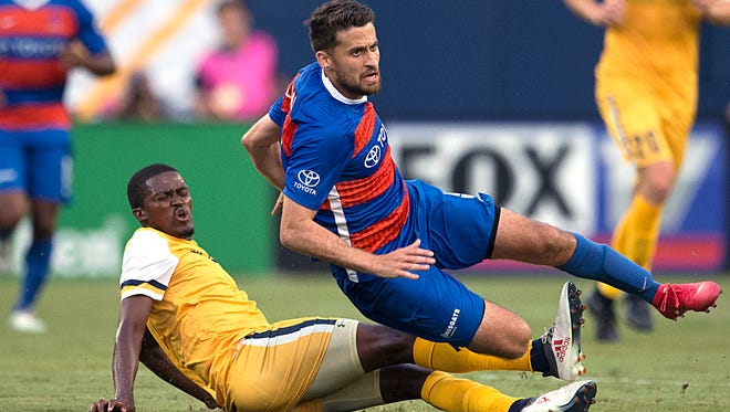 Nashville's Lebo Moloto (10) collides with against FC Cincinnati's Nazmi Albadawi (5) during a game on Saturday, July 7, 2018 at Nissan Stadium in Nashville, Tenn.