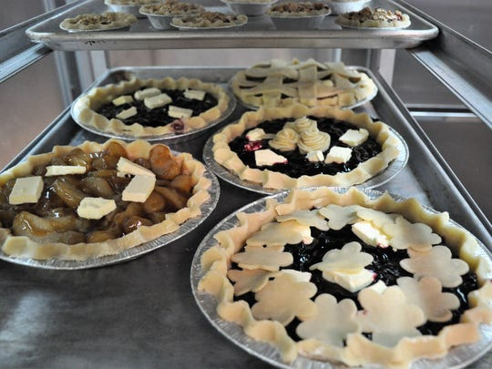 Fruit pies with pats of butter and decorative crust tops wait to be baked on Thursday at the TSTC Culinary Arts program.