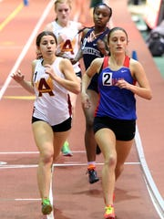 Emily Pinheiro of Arlington and Katie Turk of Carmel compete in the 1000m at the Northern Counties indoor track and field championships at the Armory in Manhattan on Jan. 28. Turk went on to win.