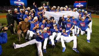 The Cubs celebrate their National League pennant.