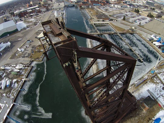 The Pere Marquette Railroad Bridge stands at the mouth of the Black River.