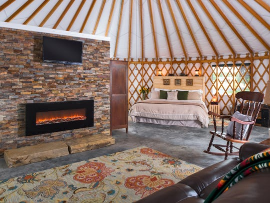 The cozy interior of a Yale Manor House yurt.